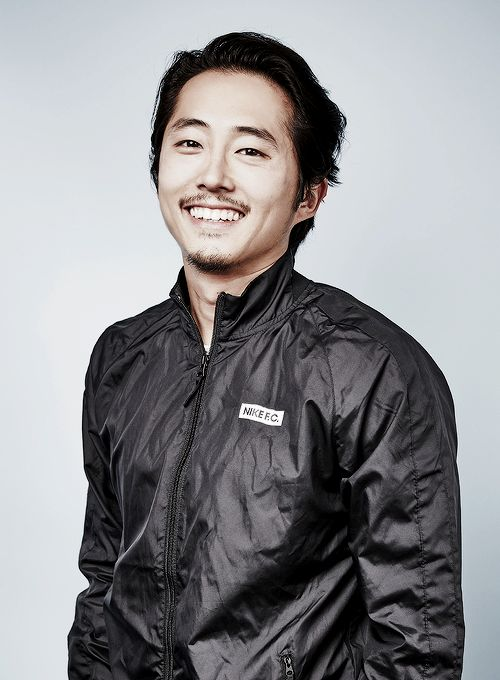 dailytwdcast:  Steven Yeun of 'The Walking Dead' poses for a portrait at the  Getty Images Portrait Studio Powered By Samsung Galaxy At Comic-Con  International 2015 at Hard Rock Hotel San Diego on July 11, 2015 in San  Diego, California