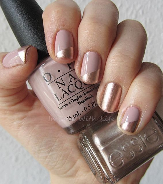 Diagonal Two Toned Rose Gold Nails: Rose gold and dusty pink are hot wedding colors. If you can't decide between either try a two-toned design like this one for your wedding nails! This is one of the more modern wedding nail ideas in this round-up.