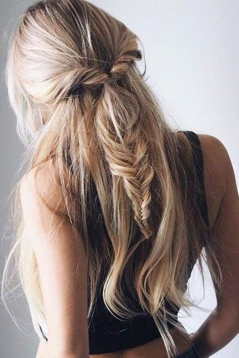 Girl with twisted half-up messy fishtail braid.
