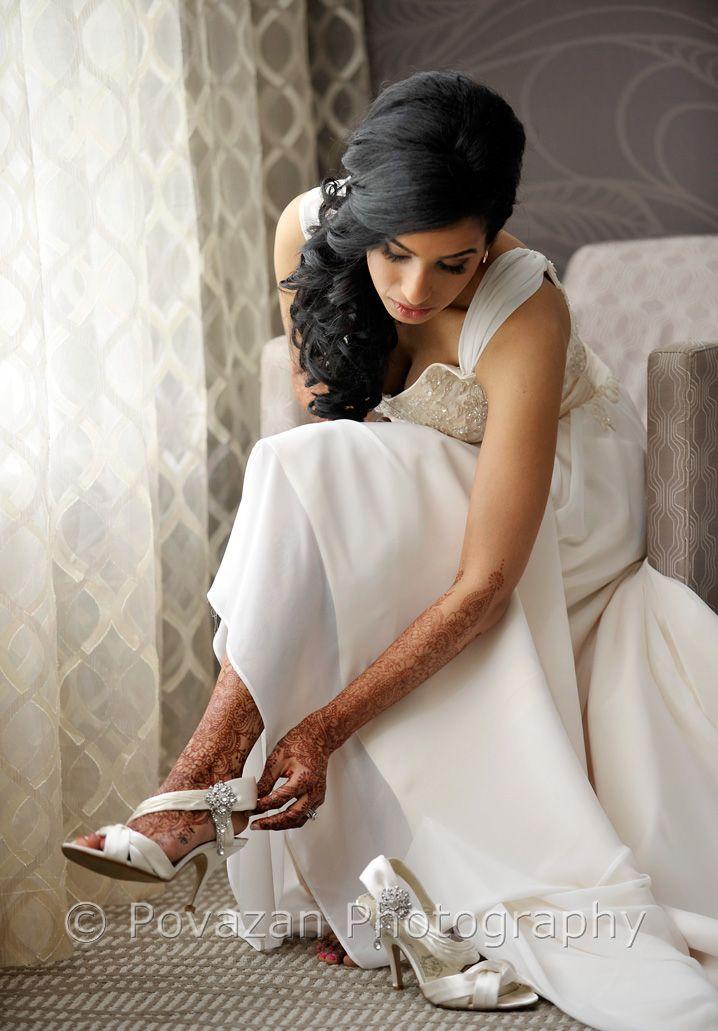 Ismaili bride putting on wedding shoes, captured by Povazan Photography - Vancouver commercial wedding photographers