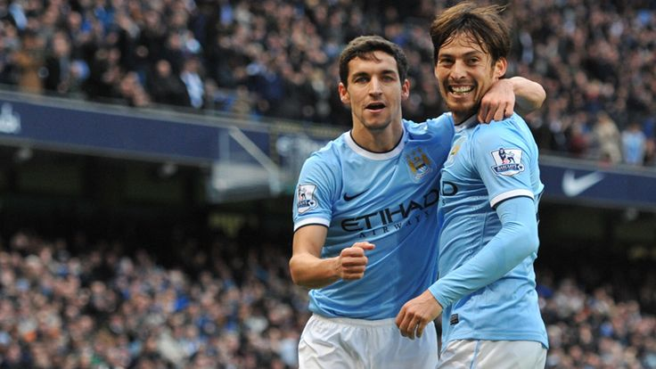 Jesus Navas and David Silva celebrate the latter's goal during the 6-3 victory over Arsenal.