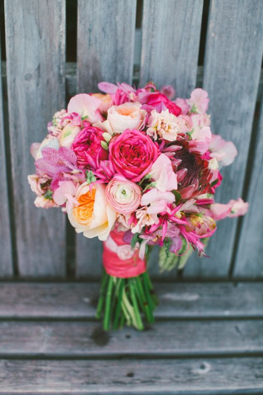 hot pink bouquet recipe: protea, piano roses, David Austin, Juliet, and garden roses, peach stock, nerine lily, sweet pea, mokara orchids, ranunculus, dusty miller and hanging amaranthus.