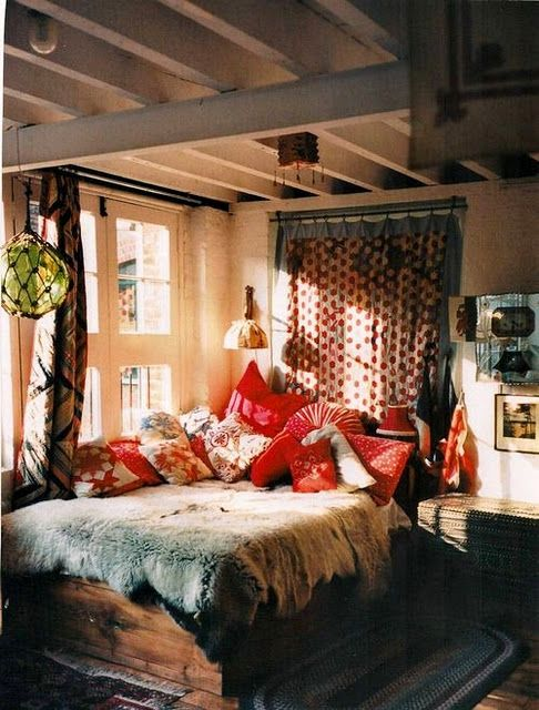 cozy bedroom with mixedprints like it except for the animal skin