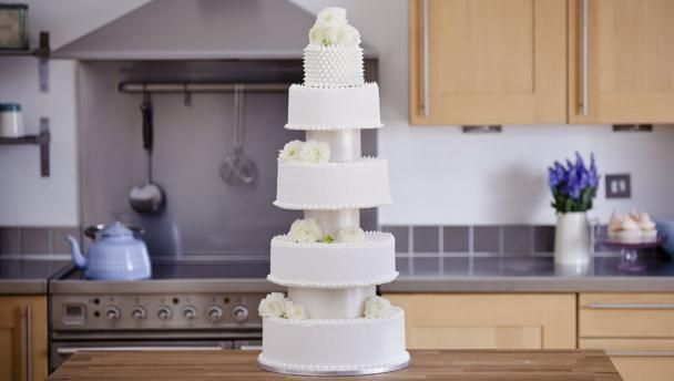 Extravagant five-tiered wedding cake |      Equipment and preparation: For this recipe you'll need 25cm/10in, 22cm/8½in, 18cm/7in, 15cm/6in and 10cm/4in round cake tins and respective thin cake boards. To assemble the cakes, you'll need a 30cm/12in cake drum, 16 dowelling rods, three 12cm/4½in thin cake board and three 12cm/4½in polystyrene cake spacers covered in ribbon. All of these are available from specialist cake shops.