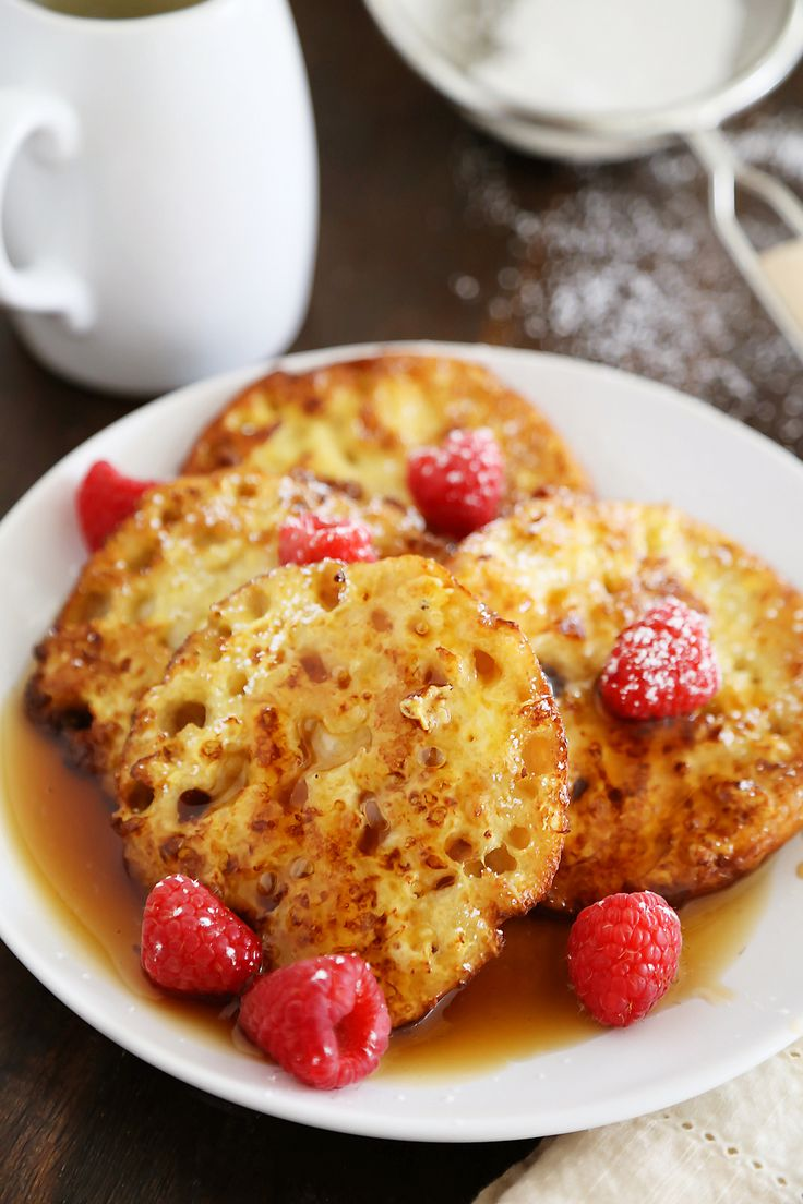 English Muffin French Toast - Fluffy, buttery French toast made from English muffins + topped with berries! Thecomfortofcooking.com