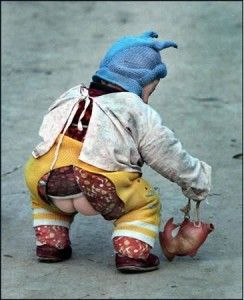 """Chinese babies wear """"kaidangku"""" (literally """"open-crotch pants"""") instead of diapers.  All children, in all seasons dress like this.  They squat at the curb on their mother's laps to pee.  Environmentally a sound idea!"""