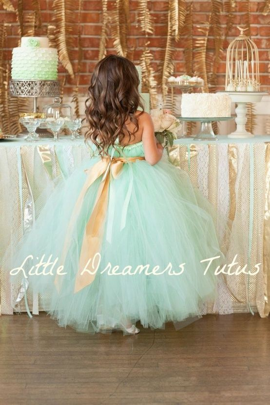 This flower girl dress in mint green with a gold sash is too cute.