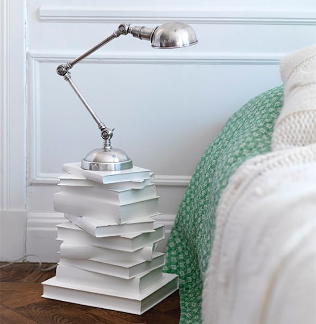 Paint it White: Paint some big books white & stack them high! - 18 Ways to Upcycle Books via Brit + Co. -- Good for defunct dictionaries, encyclopedias, and textbooks.