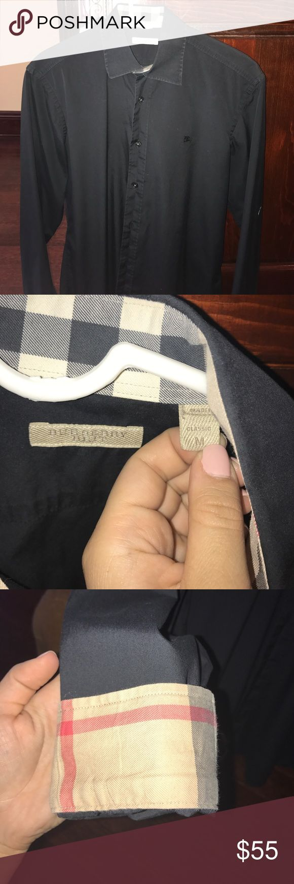 Men's Burberry Dress Shirt Medium Men's Burberry Dress Shirt. Navy Blue. Like new. My brother wore it a handful of times. Doesn't fit him anymore. AUTHENTIC Burberry Shirts Dress Shirts