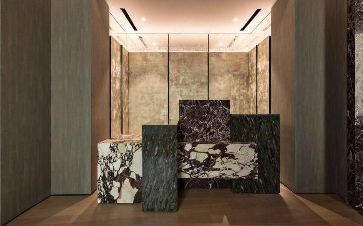 The third floor lobby at Fendi Private Suites is dominated by a monolithic desk cut from three types of marble