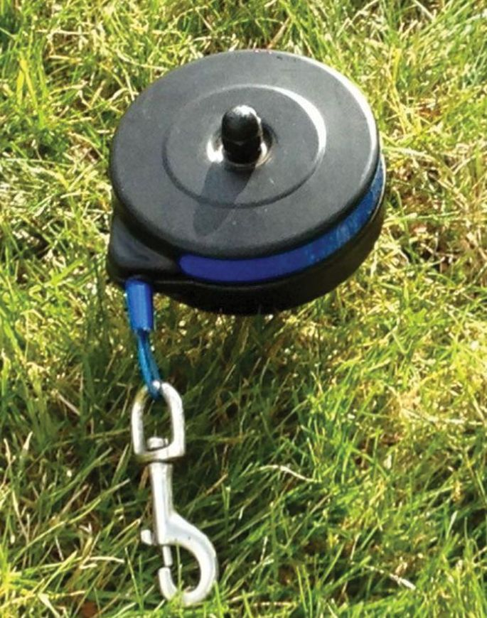 Stakes in the ground and rotates 360 degrees to keep your dog secure in your yard or at your campsite. The 20' cable retracts to prevent tripping or tangling while giving your pet 1256 sq. ft. to roam