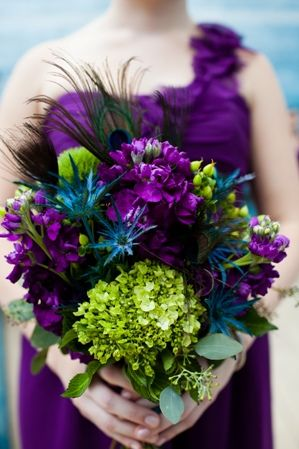 WEDDING FLOWERS: The wedding flowers truly popped with the peacock theme of bight african purple, lime green, and jewel blues. And of course the peacock feather accents. The short chiffon, deep purple bridesmaid dresses - Austin Texas Wedding at Blanton Museum by Jenny DeMarco Photo on Marry Me Metro58