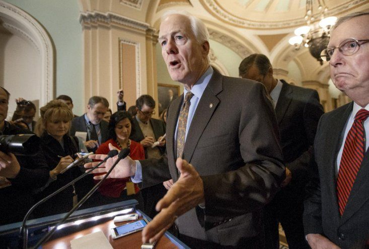 Senate Majority Whip John Cornyn of Texas, accompanied by Senate Majority Leader Mitch McConnell of Ky., right, talks with reporters on Capitol Hill i...
