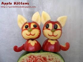 apple carving sculpture cats