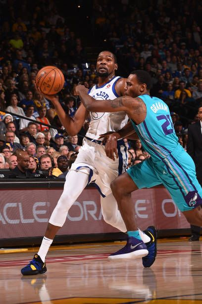 Kevin Durant of the Golden State Warriors handles the ball against the Charlotte Hornets on December 29 2017 at ORACLE Arena in Oakland California...