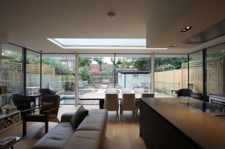 minimal windows with roof light above on single storey extension