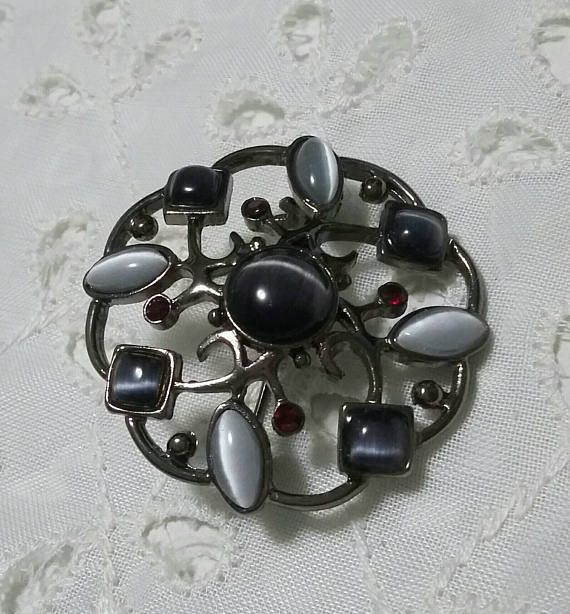 Vintage moonglow cats eye stone brooch