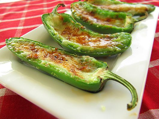 Stuffed Grilled Jalapenos recipe - Foodista.com -- now wrap these babies with some bacon, after chucking in some minced jicama or water chestnuts, and you are darned near perfection in a snack!
