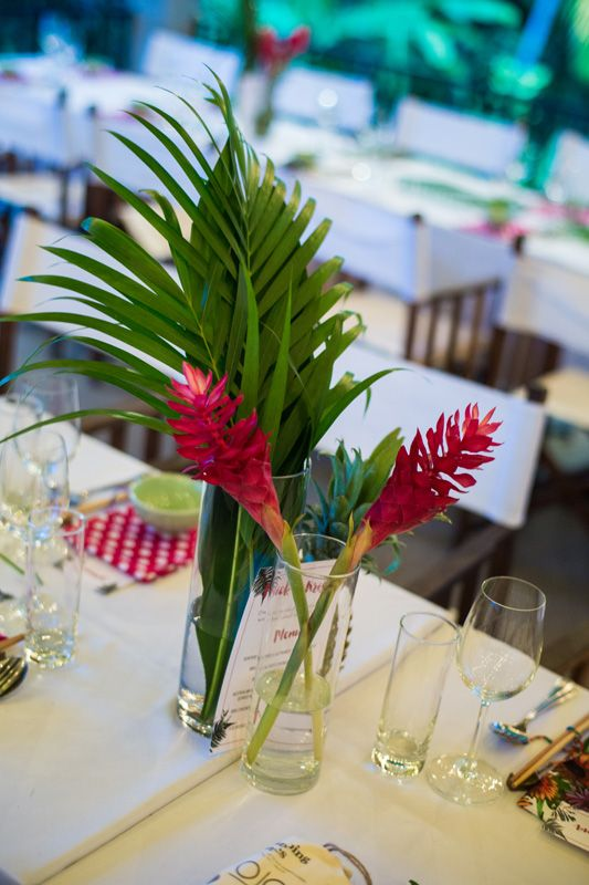 Beautiful, simple tropical centerpiece. Flower arrangement by Hoi An Events. #HoiAnEventsWeddings #VietnamBeachWeddings