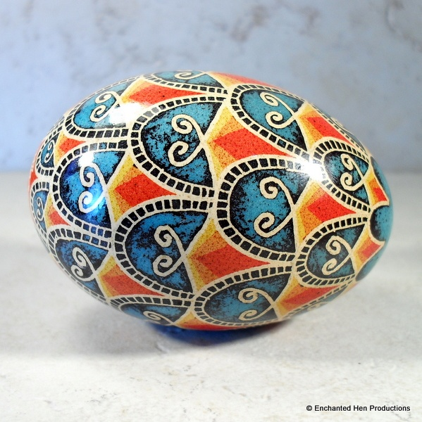 Koi egg, vinegar etch with color. Very interesting process and gorgeous result, here!