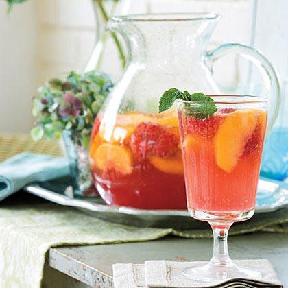 This delicious peach sangria calls for fresh peach slices, fresh raspberries, and peach nectar for its fantastic flavor. Be sure to use rosé, not white Zinfandel, in this cool sangria.
