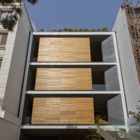 Rotating rooms give this Iranian house a shape-shifting facade.