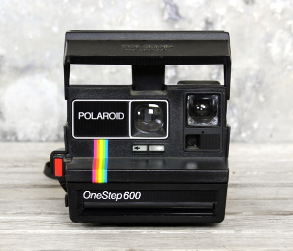 Polaroid Camera I want to do polariods...maybe with some props of some sort at the reception... it's just enough unique... Hey, people can take a souvenier:) Maybe that gets me off the hook for favors?