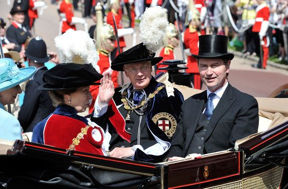 Queen Elizabeth II and Members Of The Royal Family Attend The Order Of The Garter Service. Prince Richard, Duke of Gloucester waves beside Vice Admiral Sir Timothy Laurence (R) and Princess Anne, Princess Royal as they attend the annual Order of the Garter Service at St George's Chapel, Windsor Castle on June 18, 2011 in Windsor, England. The Order of the Garter is the senior and oldest British Order of Chivalry, founded by Edward III in 1348.