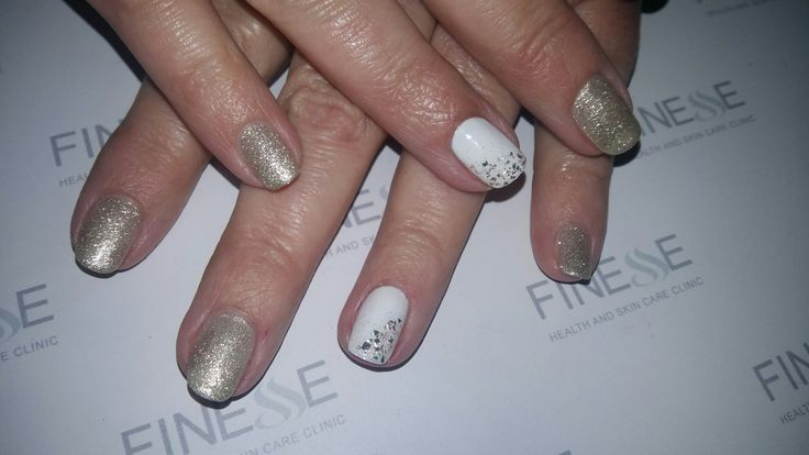 Champagne nails with white accent nails and mylar