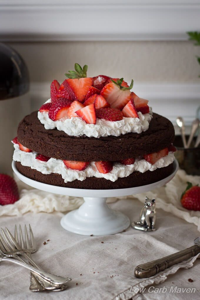 :-)chocolate cake made with almond flour and filled with strawberries and whipped cream! Yum.