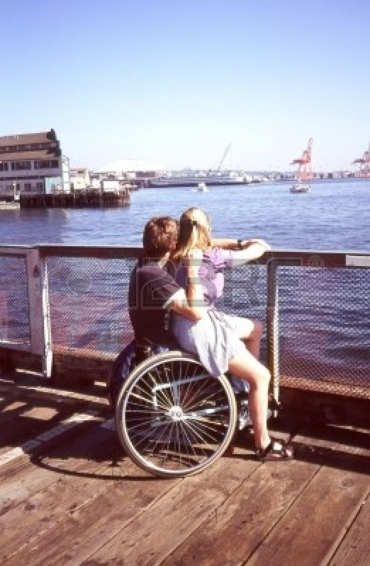 Wheelchair Couple Relaxing Together On A Pier Gt Gt Gt See It