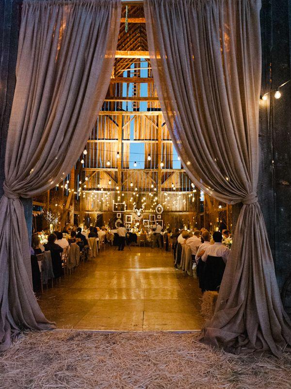 barn wedding, curtains, strung lights, candles, burlap, frames, antlers