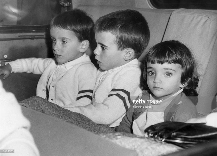 Elizabeth Taylor's three children, Michael, Christopher and Elizabeth at London Airport after their mother and her latest husband, Eddie Fisher, had flown in to make a new film.