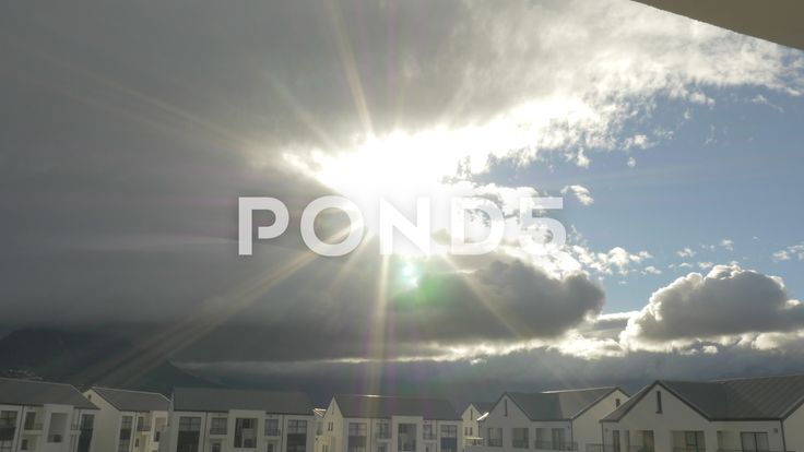 4k Sunlight Lens Flare Shining Through Grey Clouds Over Mountain Time Lapse - Stock Footage | by RyanJonesFilms