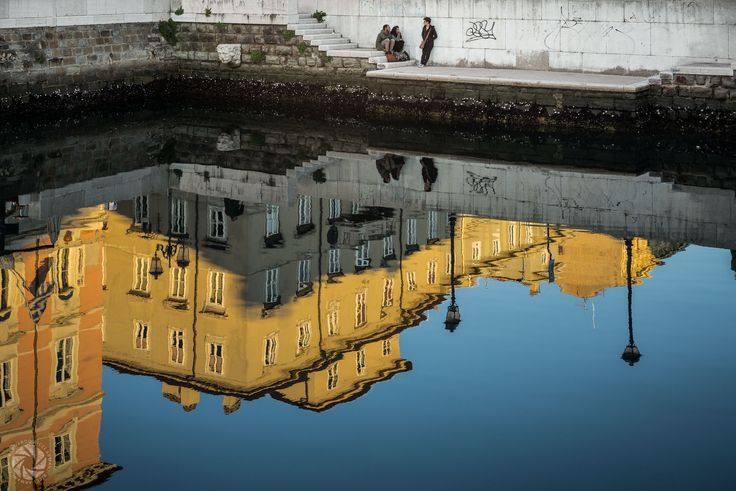 Reflections on the Canal Grande in Trieste at Sunset