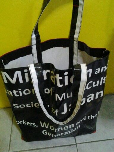Recycled tarpaulin tote bag. Send us used tarps and we will create this handy tote bag for you. Sizes small, medium nd large