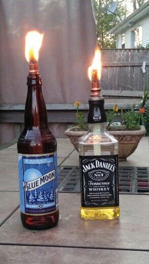 Diy tiki torches consideritdoneson citronella for Diy beer bottle tiki torches