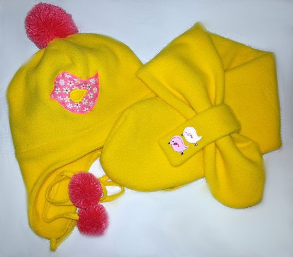 Handmade yellow winter fleece hats for kids with scarfs decorated with cute appliques, pom poms and wooden buttons. Size 2-4 Y