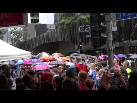 Fans are waiting for Chris Hemsworth to come out in the rain at the Thor...