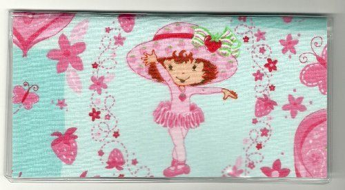 "Strawberry Shortcake Tutu Ballet Ballerina Blue Checkbook Cover by Tickled Pink Boutique. $5.99. The sturdy clear VINYL COVER encases a fabric bonded design. Measuring 6 1/4"" x 3 1/4"",  the cover fits all standard bank checkbooks and banking registers.  All checkbook covers come with a register flap and a duplicate check flap  just like the bank, only flashier.  These checkbook covers are a great alternative to the expensive covers offered by banks and online check companies."