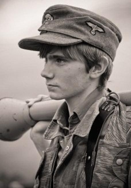 Young German home defense solider holding Panzerfaust, one of the first anti-tank weapons which took great bravery to use!