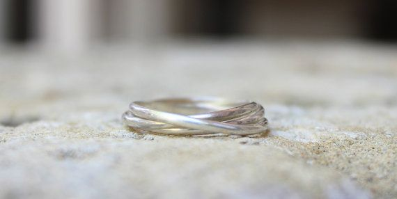 Rolling rings are timeless! Three Band Rolling Ring by DreamingTreeCreation on Etsy