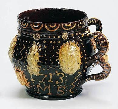 A dated Wrotham slipware large two-handled cup or tyg. c.1713, probably by John Eaglestone.
