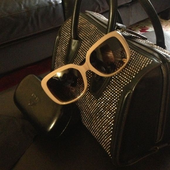 """MCM SUNGLASSES TAUPE & BLK AUTHENTIC MCM BRAND NEW SUNGLASSES PLASTIC FRAMES IN A TAUPE, HAS BLACK ARMS WITH GOLD TONE HARDWARE. COMES WITH BLACK LEATHER MCM GLASSES CASE AND BLACK CLOTH. MY PRICE IS FIRM THANK YOU AND HAPPY POSHING ...✨APPOX 7 1/2"""" FROM RIGHT TO LEFT.. NWOT MCM Accessories Sunglasses"""