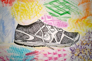 contour drawing of student's shoe, then background is rubbings made from the bottoms of shoes. cool.