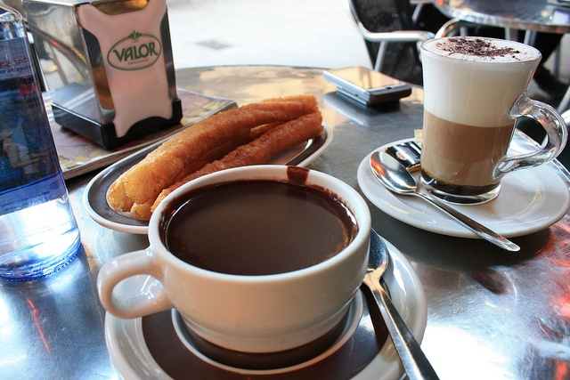Churro Cafe in Madrid, Spain (via everywhereist).  My favorite breakfast in the world: Churros y Chocolate!  No redeeming nutritional value whatsoever, but it's vacation!
