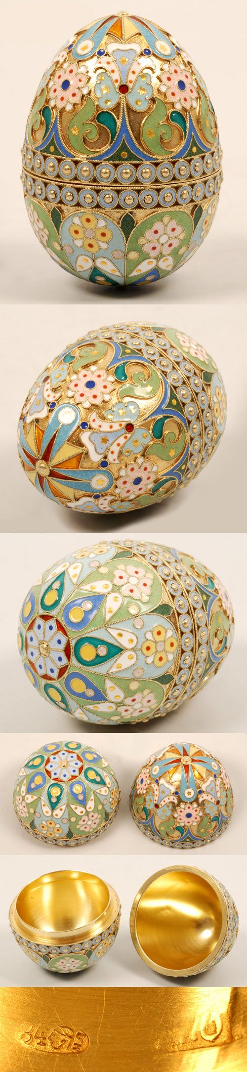 A Russian silver gilt and cloisonne enamel egg, Pavel Ovchinnikov, Moscow, circa 1896-1908. The two-part egg decorated in pastel multi-color stylized scroll, flower and geometric motifs with a double band of pale blue enamel circles centered with raised gilded silver beads.
