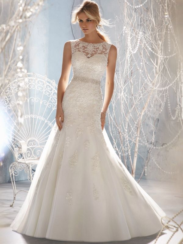 Mori Lee Daisy. Lace wedding dress with illusion neckline, v back, lace appliques and fit & flare tulle skirt. Try it now, at Bellissima Weddings Essex