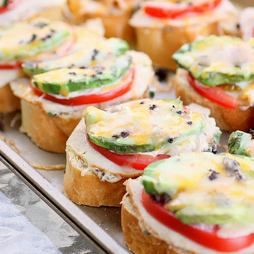 turkey, avocado, tomato and cheese open face sandwich.  Would be good as an app too.