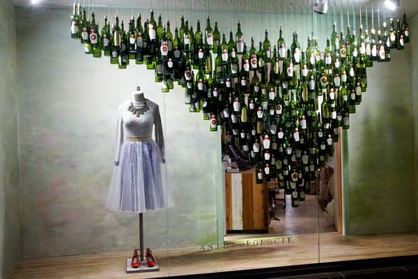 Holiday Windows NYC - Best Christmas Displays - Love the idea of using wine bottles as decorating raw materials.